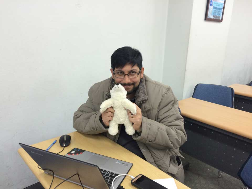 My lecturer Habib holding Björn, my travel bear